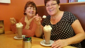 Ladies having a scrumptious treat after stroll around the Winter Gardens.